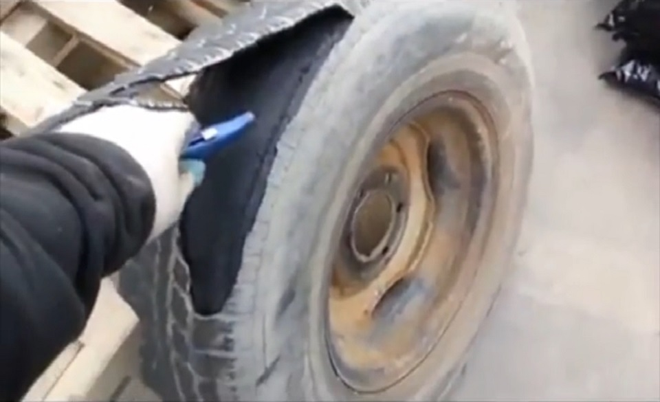 Worlds-Dumbest-Man-Almost-Kills-Himself-With-A-Tire-960x585