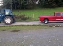 Dodge-Ram-Cummins-vs-Ford-Tractor-in-a-Tug-of-War-1