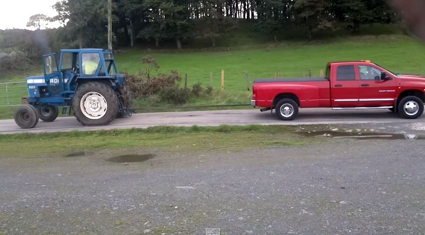 Dodge-Ram-Cummins-vs-Ford-Tractor-in-a-Tug-of-War-1