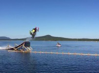 World-first-snowmobile-backflip...-on-water