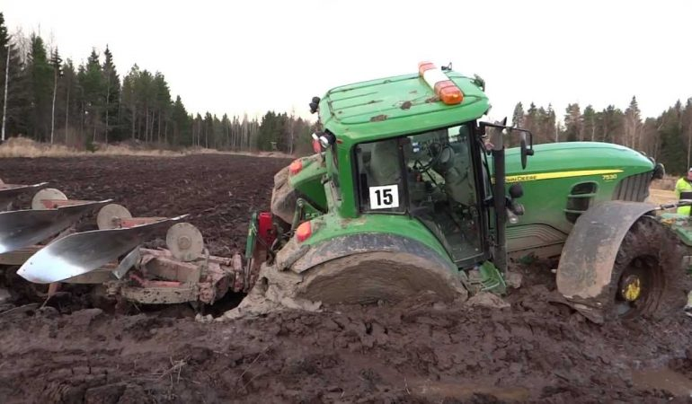 john-deere-7530-successfully-salvaged-by-case-ih-tractor-from-a-deep-mud-2zqb07x9yo6juxvkmhd4ay